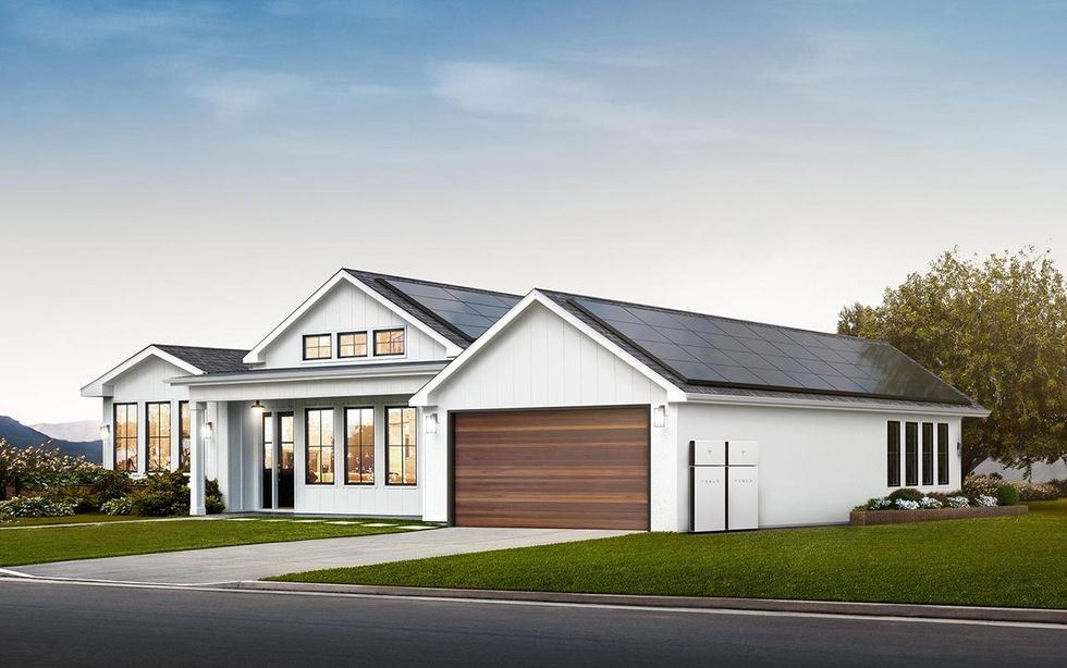 Home with Tesla solar panels and Tesla Powerwall+ Batteries
