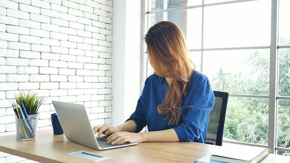 Woman updates her resume