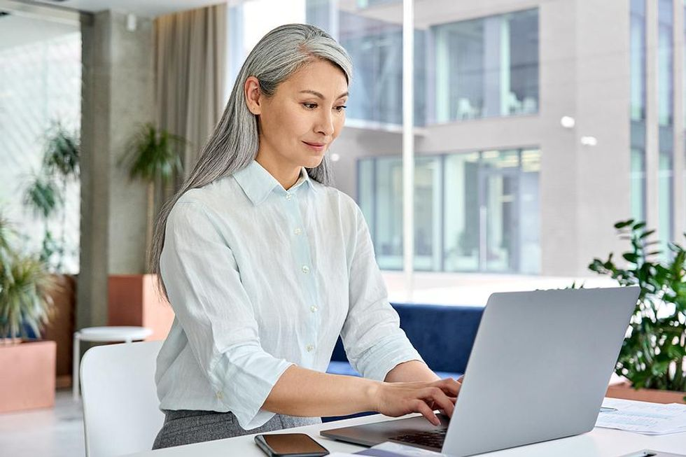 Middle aged woman researches how to change careers