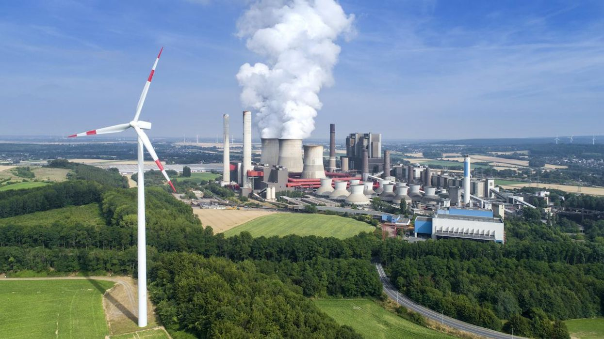 A wind turbine and coal power station in Germany.