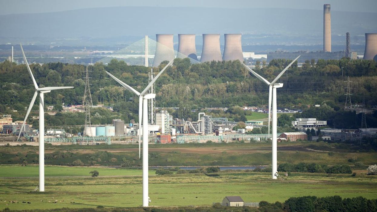 Wind turbines near the Fiddlers Ferry decommissioned coal-fired power station.