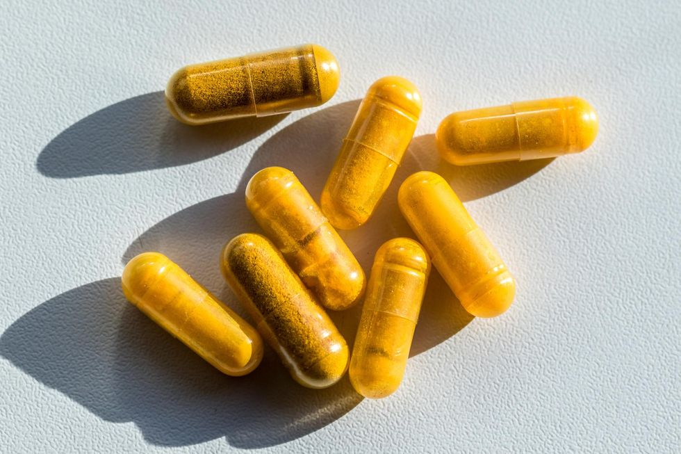 Close up of turmeric capsules on the table