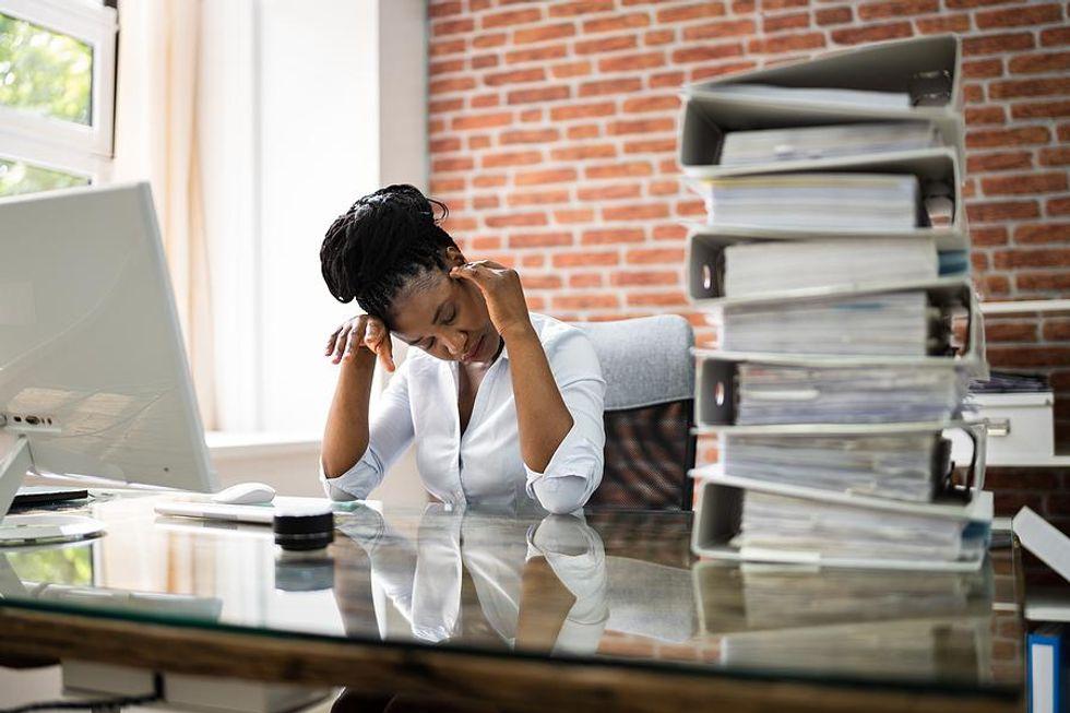 Professional woman experiencing job burnout