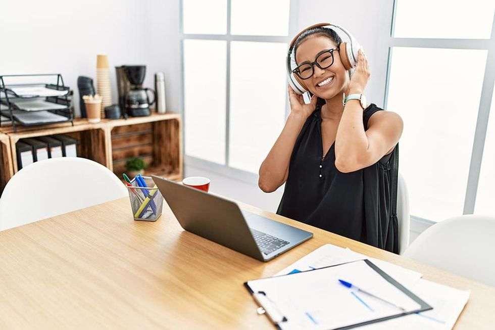 Happy woman manages her career