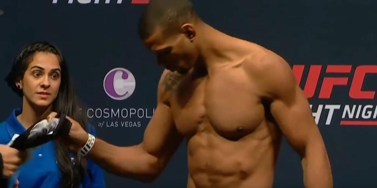 This Female UFC Attendant Eye-Fucks The Fighters At A Weigh-In For All Of Us