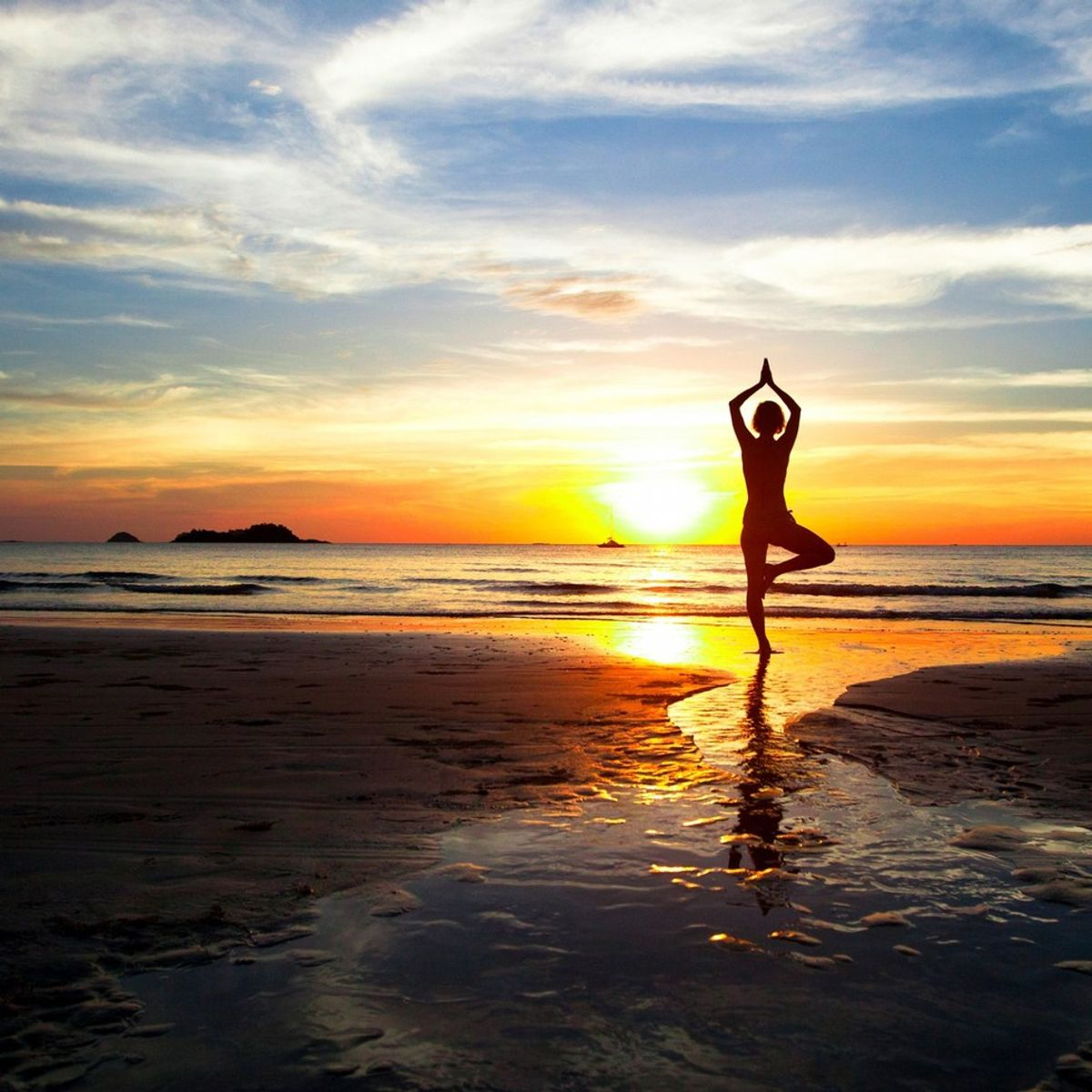 Why You Should Totally Do Beach Yoga