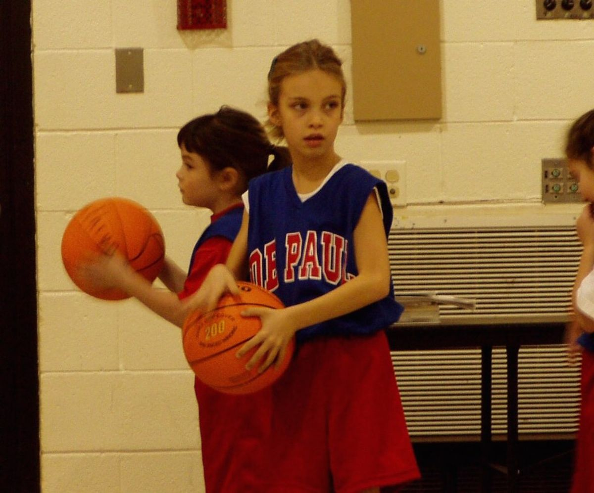 To The Little Girl Picking Up A Basketball For The First Time