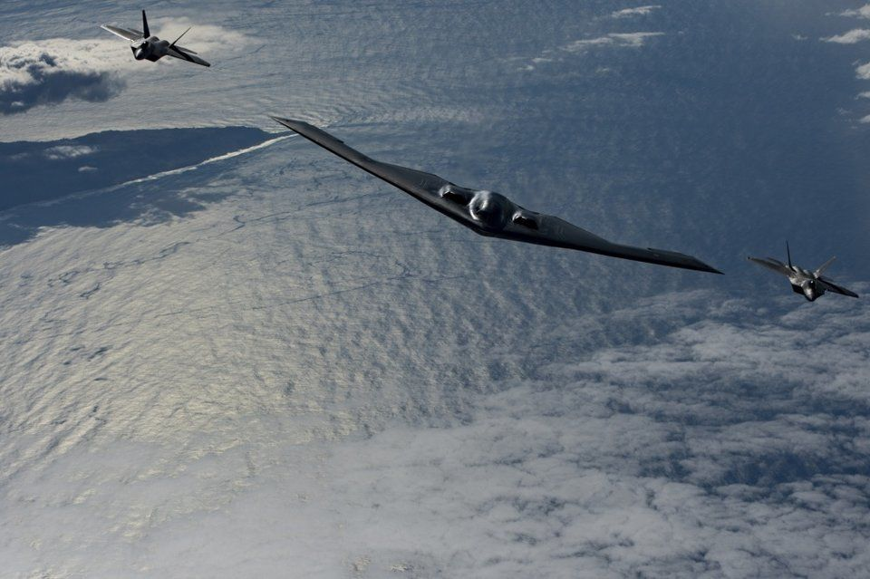 US Air Force F-22s, B-2 Bombers Prowl The Pacific: Photos - Task