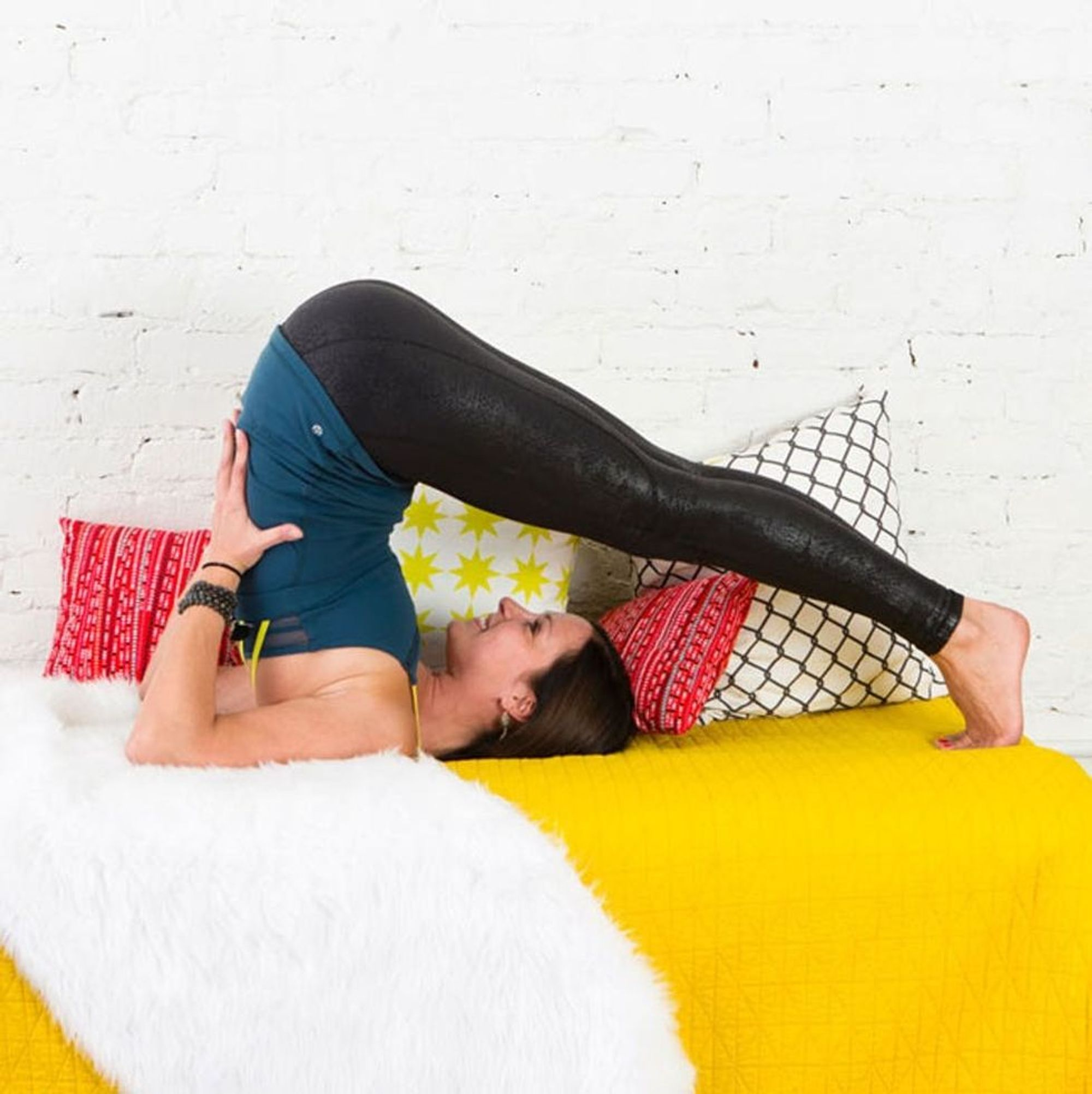 47 Lazy Girl Yoga Poses You Can Do Without Leaving Your Bed - Brit + Co